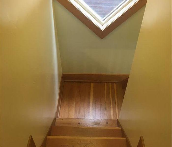 A stairwell newly re-trimmed and repainted after mitigation.