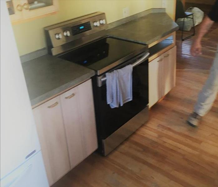A kitchen stove-top range and counter post-mitigation.