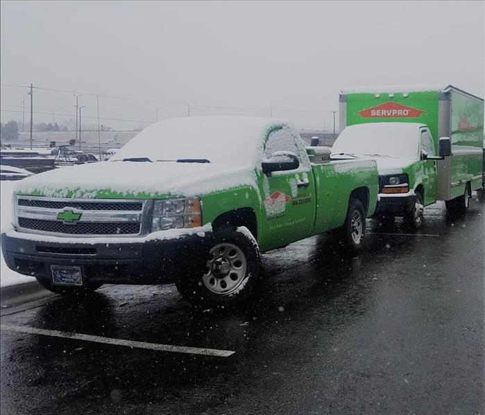 SERVPRO company trucks being snowed on.