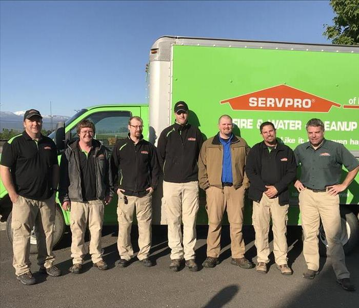 The technicians of SERVPRO of Missoula standing in front of one of the SERVPRO trucks.