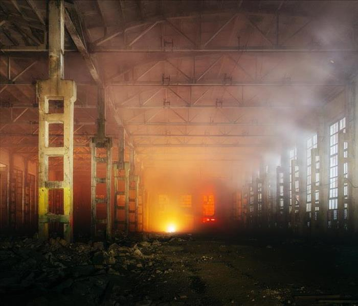 Burned-out warehouse full of smoke.